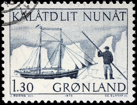schooner: GREENLAND - CIRCA 1975: A stamp printed by DENMARK shows view of The schooner Sokongen (The King of Seas) against icebergs, circa 1975