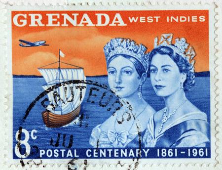 queen elizabeth ii: GRENADA - CIRCA 1961: A stamp printed by GRENADA shows image portraits of Queen Victoria and Queen Elizabeth II against Caribbean Sea, circa 1961