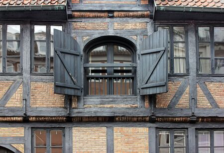 fachwerk: A view of the old European half-timbered house windows with wooden shutters. Suitable for an abstract background.