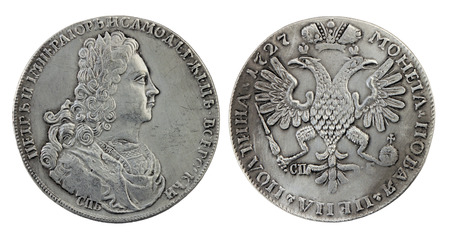 petrovich: Closeup view of the Russian ruble from 1727 (first year of Peter II reign) against white background. Peter II Alexeyevich was the only son of Tsarevich Alexei Petrovich, son of Peter the Great Stock Photo