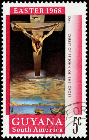surrealist: GUIANA - CIRCA 1968: A stamp printed by GUIANA shows painting Christ of Saint John of the Cross by famous Spanish surrealist painter Salvador Dali, circa 1968
