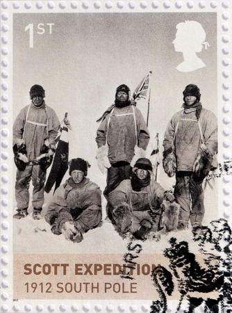 expeditions: UNITED KINGDOM - CIRCA 2012: A stamp printed by UNITED KINGDOM shows Scott Expedition at South Pole. Royal Navy officer Robert Falcon Scott who led two Antarctic expeditions, circa 2012.