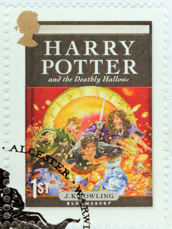 harry: UNITED KINGDOM - CIRCA 2007: A stamp printed by GREAT BRITAIN shows image of cover of Harry Potter and the Deathly Hallows novel by Joanne (Jo) Rowling, pen names J. K. Rowling, circa 2007.