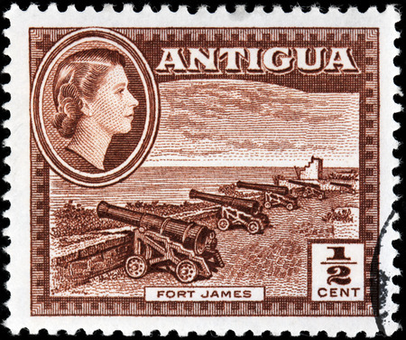 ANTIGUA - CIRCA 1956: A stamp printed by ANTIGUA shows view of old cannons in Fort James. Fort James is a fort at the entrance to the harbor of St. Johns, Antigua and Barbuda, circa 1956