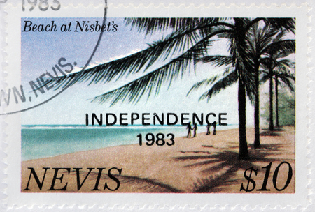 trees services: NEVIS - CIRCA 1983: A stamp printed by NEVIS shows view of the Beach at Nisbet, circa 1983