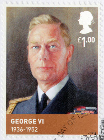 dominions: UNITED KINGDOM - CIRCA 2012: A stamp printed by GREAT BRITAIN shows image portrait of George VI - King of the United Kingdom and the Dominions of the British Commonwealth, circa 2012 Editorial