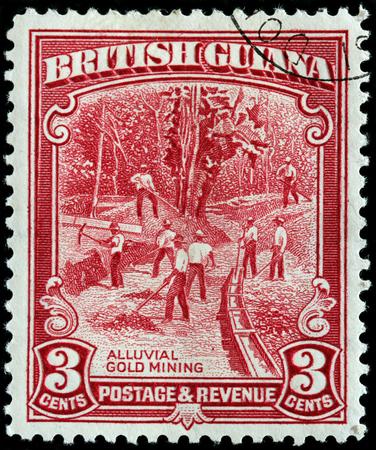 alluvial: BRITISH GUIANA - CIRCA 1934: A stamp printed by BRITISH GUIANA shows view of Alluvial Gold Mining, circa 1934 Editorial