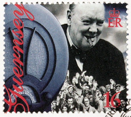 guernsey: GUERNSEY - CIRCA 1995: A stamp printed by GUERNSEY shows image portrait of Winston Churchill and old wireless radio receiver. 50th Anniversary of Liberation, circa 1995 Editorial