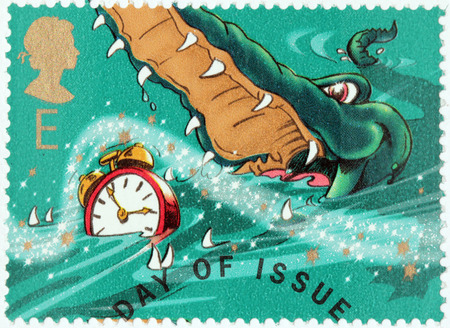 barrie: UNITED KINGDOM - CIRCA 2002: A stamp printed by GREAT BRITAIN shows Crocodile and Clock from Peter Pan stories by Scottish novelist and playwright James Matthew Barrie, circa 2002.