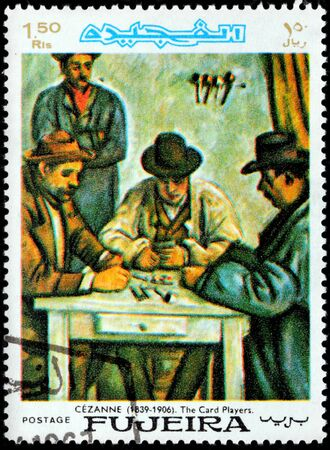 FUJAIRAH - CIRCA 1967: A postage stamp printed by FUJAIRAH shows painting The Card Players by famous French painter Paul Cezanne, circa 1967.