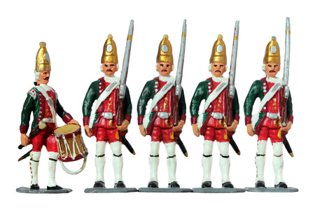 green military miniature: Set of five ancient tin toy soldiers. Prussian armed by flintlock muskets infantry soldiers and military drummer against white background. Army of Frederick the Great, Prussian infantry 1740. Stock Photo