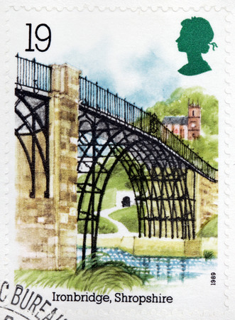 severn: UNITED KINGDOM - CIRCA 1989: A stamp printed by GREAT BRITAIN shows view of the Ironbridge - a settlement on the River Severn, at the heart of the Ironbridge Gorge, in Shropshire, circa 1989 Editorial