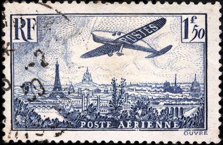 notre dame cathedral: FRANCE - FEBRUARY, 1936: A stamp printed by FRANCE shows Plane flying over Paris. Beautiful Paris cityscape with Eiffel tower, Notre Dame Cathedral and Sacre Coeur in Montmartre hill