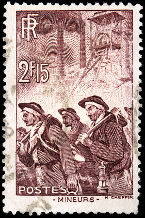 mineros: SAINT-PETERSBURG, RUSSIA - CIRCA JULY 14, 1938: A stamp printed by FRANCE shows miners, circa April, 1938 Editorial