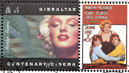 curtis: GIBRALTAR - CIRCA 1995. A postage stamp printed by GIBRALTAR shows American actress Marilyn Monroe, actors Jack Lemmon and Tony Curtis starring in the film Some Like It Hot, circa 1995. Editorial