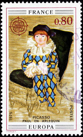 FRANCE - CIRCA APRIL, 1975: A stamp printed by FRANCE shows painting Paul as Harlequin by Pablo Ruiz y Picasso, also known as Pablo Picasso