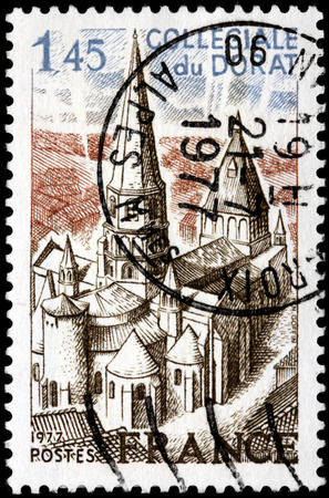 limousin: SAINT-PETERSBURG, RUSSIA - JULY 14, 2015: A stamp printed by FRANCE shows view of Collegiate church of Le Dorat - a commune in the Limousin region in western France, circa July, 1977