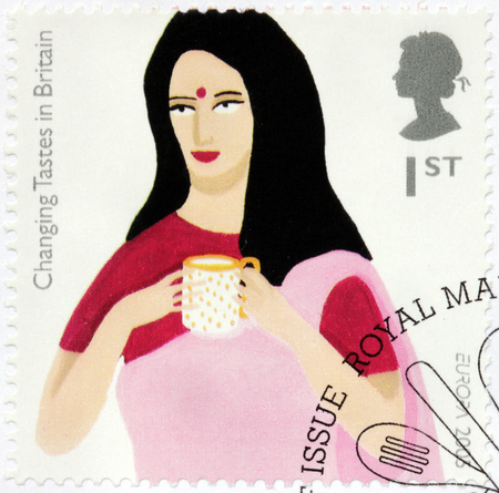 indian postal stamp: SAINT-PETERSBURG, RUSSIA - JULY 14, 2015: A stamp printed by GREAT BRITAIN shows image of Indian Woman Drinking Tea. Changing Tastes in Britain, circa August, 2005 Editorial