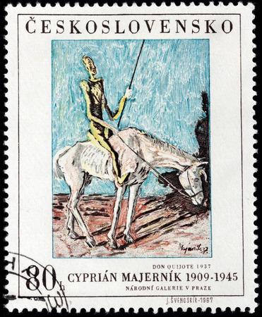 don quijote: SAN PETERSBURGO, Rusia - 10 de agosto, 2015: Un sello impreso por Checoslovaquia muestra la imagen de Don Quijote por el artista famoso Cipriano Majernik, alrededor de noviembre de 1967.