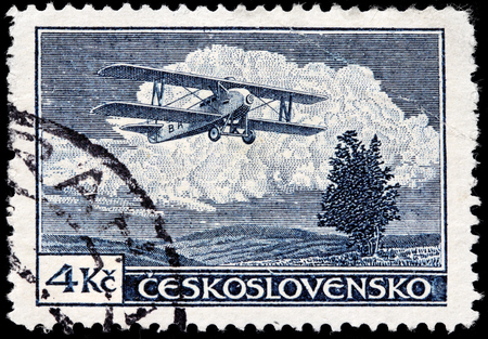 post stamp: CZECHOSLOVAKIA - AUGUST 10, 2015: A stamp printed by CZECHOSLOVAKIA shows Letov S-19 Smolik - an airplane produced in Czechoslovakia during the 1920s, circa December, 1930.