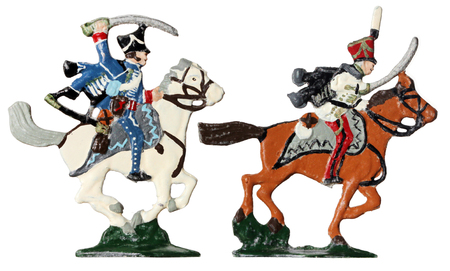 hussar: Set of two ancient tin toy soldiers. French armed by sabers and hussars horsemen in traditional clothes against white background.