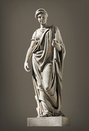 olympian: Ancient Hera Sculpture. Hera (identified with Juno by the Romans) is the Olympian Goddess of Marriage, protector of family and married women. Hera is the wife of Zeus, the king of Gods. Stock Photo