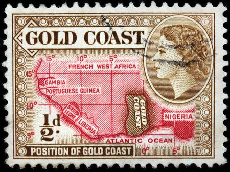 gold coast: LUGA, RUSSIA - JUNE 25, 2016: A stamp printed by GOLD COAST shows image portrait of Queen Elizabeth II against position of Gold Coast on Africa map, circa 1953 Editorial