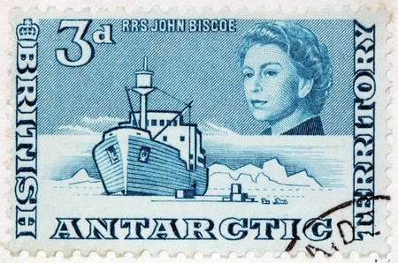 queen elizabeth ii: LUGA, RUSSIA - JUNE 25, 2016: A stamp printed by BRITISH ANTARCTIC TERRITORY shows image portrait of Queen Elizabeth II against polar landscape with famous RRS John Biscoe, circa 2013