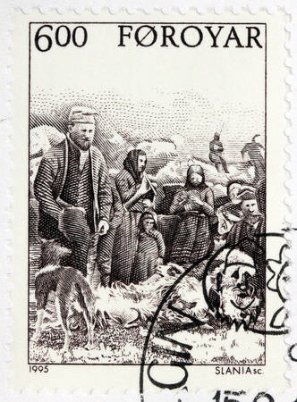 shearer: LUGA, RUSSIA - JUNE 25, 2016: A stamp printed by FAROE ISLANDS shows Faroese peasants fleecing sheep in farm, circa 1995.