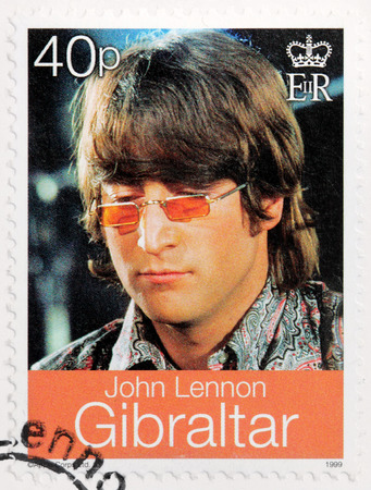 english famous: LUGA, RUSSIA - AUGUST 19, 2016: A stamp printed by GIBRALTAR shows image portrait of famous English musician, composer, singer and songwriter John Lennon, circa 1999.