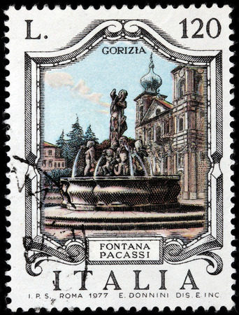 LUGA, RUSSIA - JUNE 25, 2016: A stamp printed by ITALY shows view of The Victory Square (Piazza della Vittoria) with famous Pacassi Fountain (Fontana Pacassi) in Gorizia, Italy, circa 1977