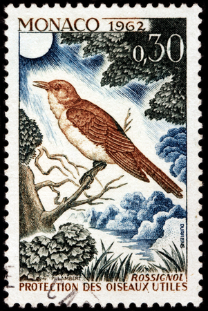 bird song: LUGA, RUSSIA - NOVEMBER 29, 2016: A stamp printed by MONACO shows thrush nightingale (Luscinia luscinia), also known as sprosser or chat - a small passerine bird, circa 1962 Editorial