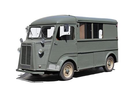 Old green delivery van (light track) at sunny summer day against white background. Reklamní fotografie - 71979965