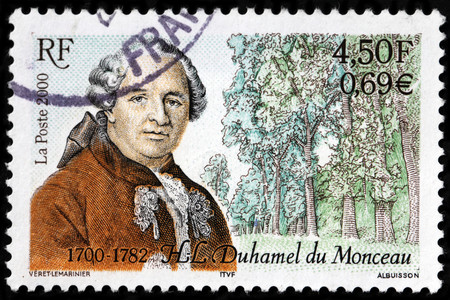 tree service pictures: LUGA, RUSSIA - SEPTEMBER 18, 2015: A stamp printed by FRANCE shows image portrait of Henri-Louis Duhamel du Monceau - a French physician, naval engineer and botanist, circa 2000