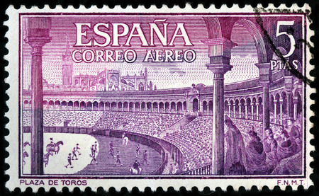 LUGA, RUSSIA - APRIL 26, 2017: A stamp printed by SPAIN shows beautiful view of Bullring - an arena where bullfighting is performed, circa 1960 Editorial