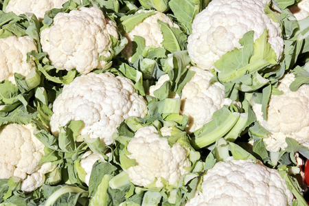 supermarket: The close-up of white cauliflower in vegetables market at sunny summer day. Healthy organic food. Suitable for an abstract background.