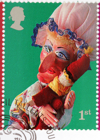 old envelope: LUGA, RUSSIA - AUGUST 20, 2017: A stamp printed by GREAT BRITAIN shows Judy glove puppet - character from Punch and Judy Puppets Show, circa 2001