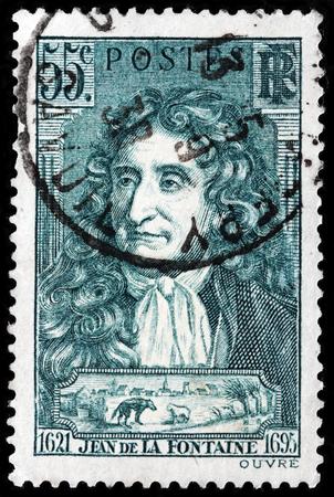 ルガ、ロシア - 2017 年 10 月 6 日: フランスで印刷スタンプがジャン ・ ド ・ ラ ・ フォンテーヌ - フランスのうそつきイメージ肖像画を示しています 報道画像