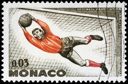 LUGA, RUSSIA - OCTOBER 6, 2017: A stamp printed by MONACO shows football goalkeeper in action, circa 1963
