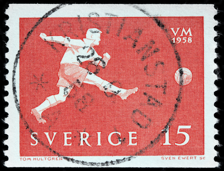 LUGA, RUSSIA - OCTOBER 6, 2017: A stamp printed by SWEDEN shows football player in action, circa 1958