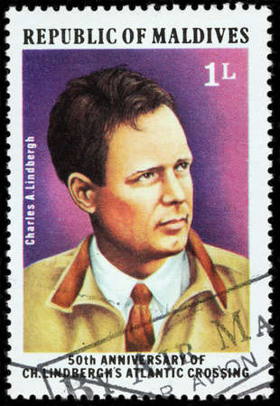 LUGA, RUSSIA - FEBRUARY 08, 2018: A stamp printed by MALDIVES shows an American aviator, military officer, author, inventor and explorer Charles Augustus Lindbergh, circa 1977 Éditoriale