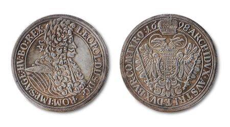 Copy of the silver thaler coin of Holy Roman Emperor, King of Hungary, Croatia, and Bohemia  Leopold I minted in 1698, isolated on a white background.