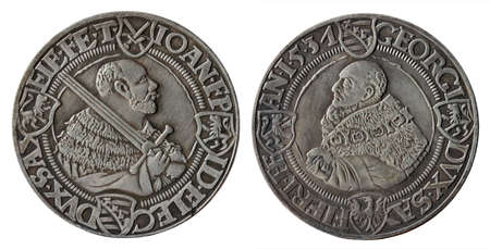 Copy of the German silver thaler coin minted in 1531 by John Frederick Elector of Saxony called the Magnanimous, isolated on a white background. Stock Photo