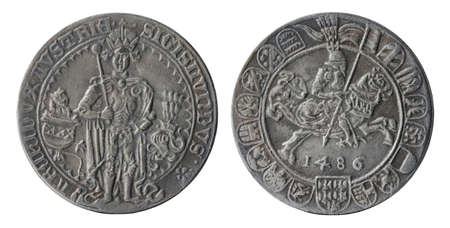Copy of the Austrian silver thaler-sized Guldengroschen coin minted in 1486 by Duke of Austria Sigismund (a member of the House of Habsburg), isolated on a white background. Archivio Fotografico