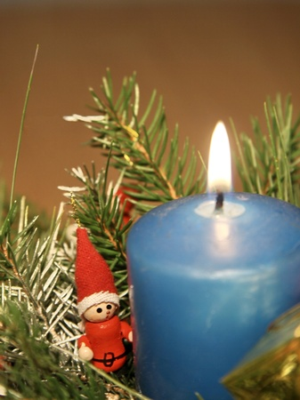 Blue candle decoration in basket of sticks Stock Photo - 16953456