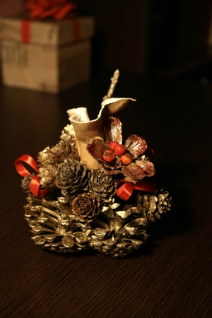 Table decoration of pine cone and gourd  photo