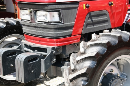agriculture machinery: Red modern tractor agriculture machinery Stock Photo