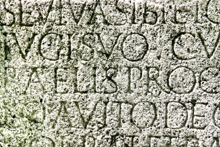 carved letters: Roman letters carved in the grave stone