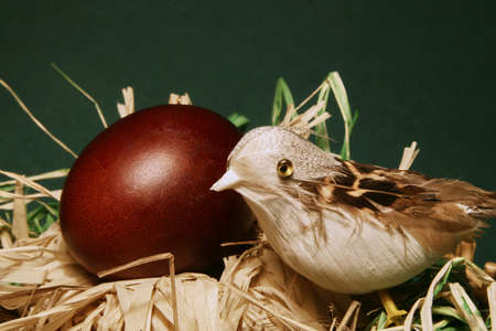 artifical: Easter egg with artifical bird in nest Stock Photo