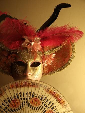 Venetian carnival mask and hand fan